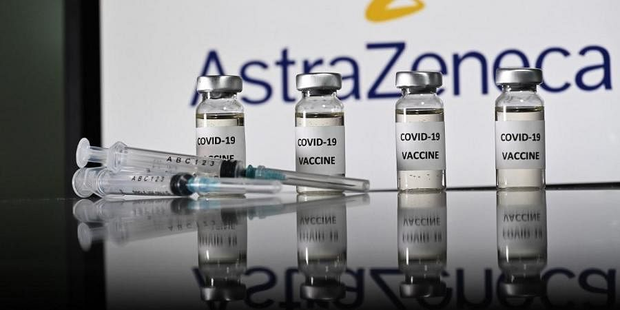 An illustration picture shows vials with Covid-19 Vaccine stickers attached and syringes with the logo of British pharmaceutical company AstraZeneca. (Photo | AFP)