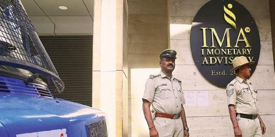Police officers outside IMA Jewels soon after the scam broke out in June 2019, after IMA founder Mansoor Khan had fled the country.