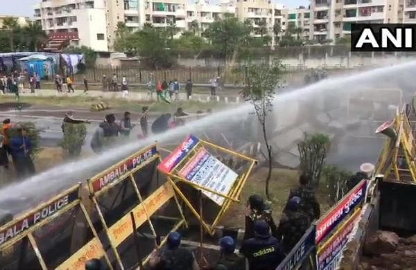 Braving tear gas shells, water canons, farmers continue their fight against farms laws