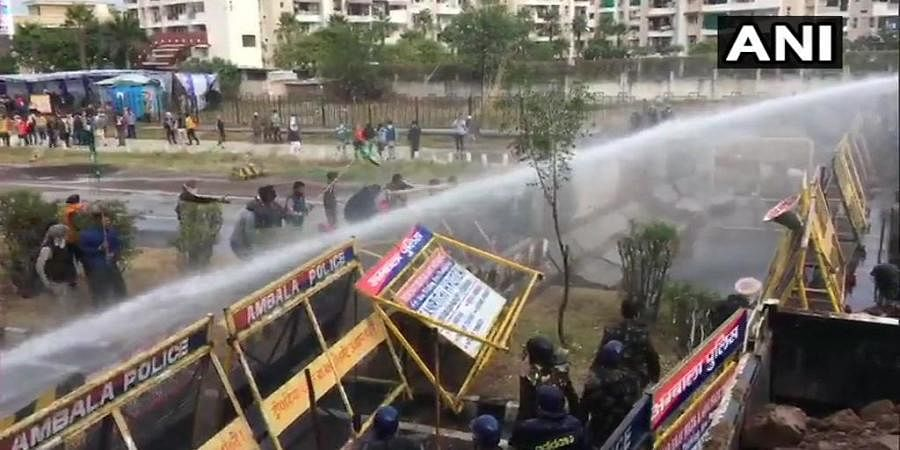 Farmers headed to Delhi to stage protest attempt to break through police barricades. (Photo| ANI)