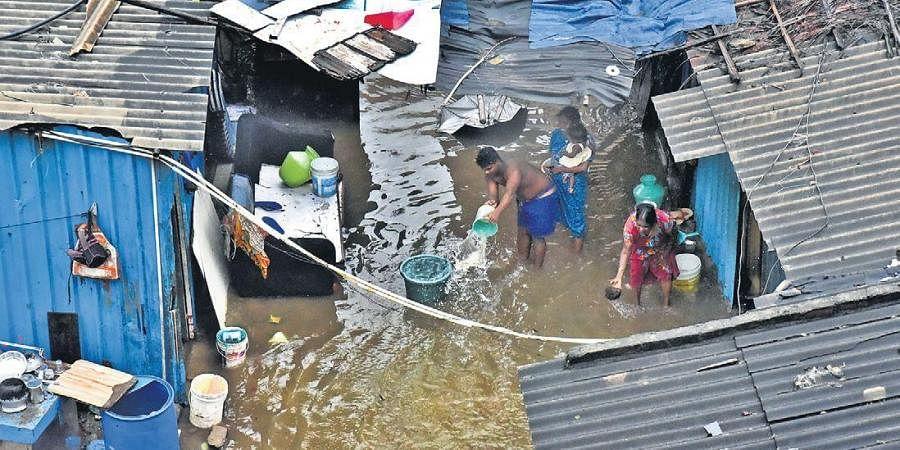 Flooded houses near Kolathur flyover in Chennai. (Photo   P Jawahar, EPS)
