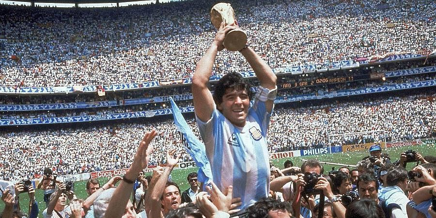 Diego Maradona holds up his team's trophy after Argentina's 3-2 victory over West Germany at the 1986 World Cup final match at Atzeca Stadium in Mexico City.