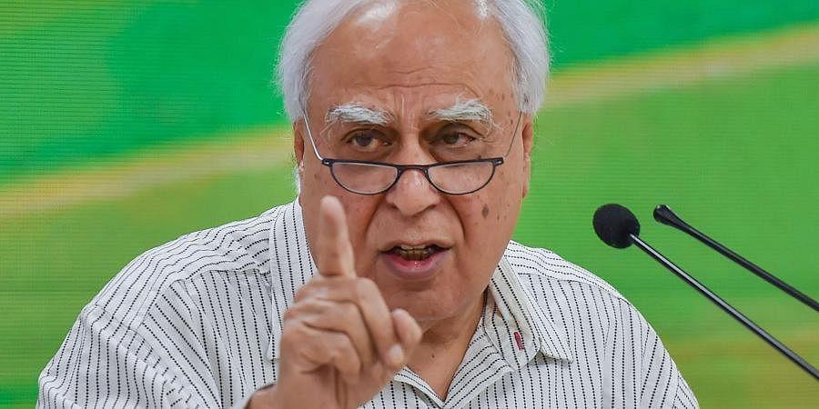 Senior Congress leader Kapil Sibal addresses a press conference at party headquarters in New Delhi.