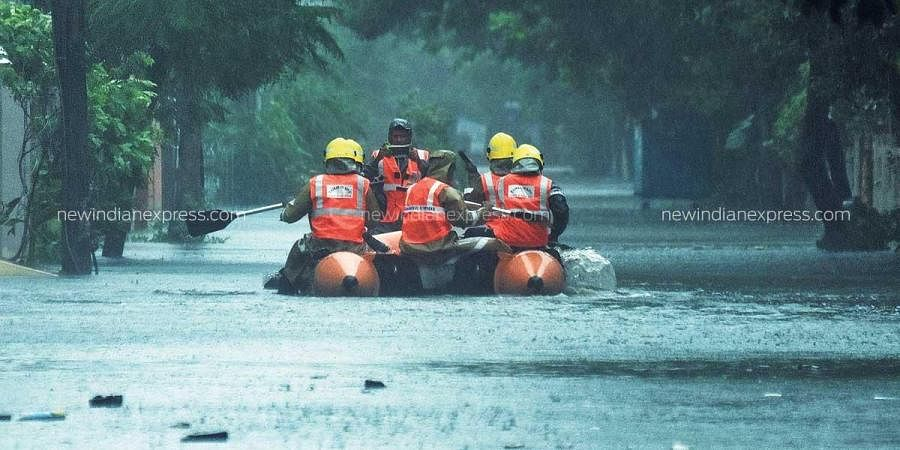Fire officials rescue people affected by the flood due to incessant rains at Velachery in Chennai. (Photo | Ashwin Prasath, EPS)