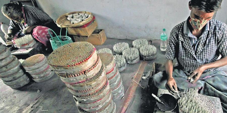 Work in progress at a fireworks factory  in Nallur near Sivakasi. (Photo | KK Sundar, EPS)