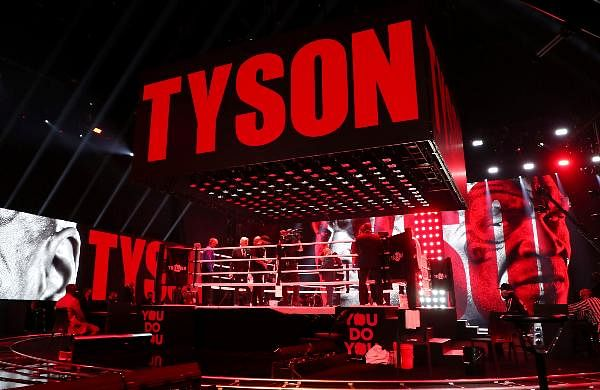 Mike Tyson enters the ring for an exhibition boxing bout against Roy Jones Jr in Los Angeles.