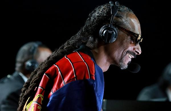 Snoop Dogg performs onstage at an exhibition boxing bout between Mike Tyson and Roy Jones Jr in Los Angeles.