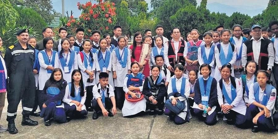 East Siang DM Kinny Singh (centre) with students and teachers of a government school; (below) a renovated school. (Photo | EPS)