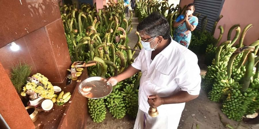 A wholesale fruit businessman performs puja before resuming operations at the  Koyambedu market