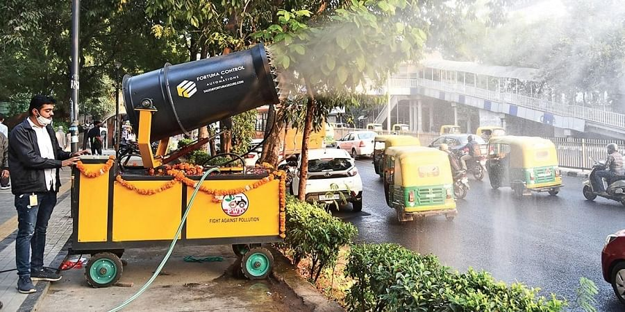 An anti-smog gun sprays water to bring down dust at the busy ITO area in New Delhi. (Photo | Parveen Negi, EPS)