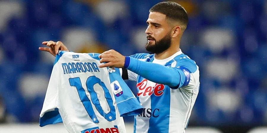 Lorenzo Insigne of Napoli holding a number 10 Maradona shirt, celebrates after scoring the first goal of the game against AS Roma