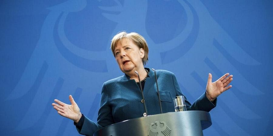 German Chancellor Angela Merkel speaks at a press conference about coronavirus, in Berlin