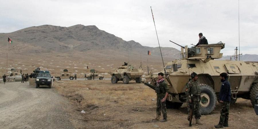 Afghan national army soldiers arrive at the site of a suicide bombing in Afghanistan's Ghazni province