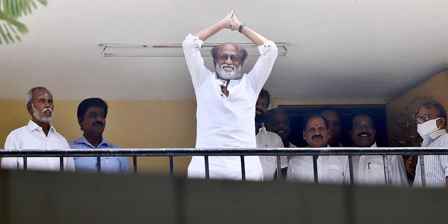 Superstar Rajinikanth greeting his supporters.