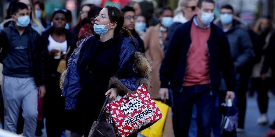 Shoppers walk along a very busy Regent Street in London. (Photo | AP)