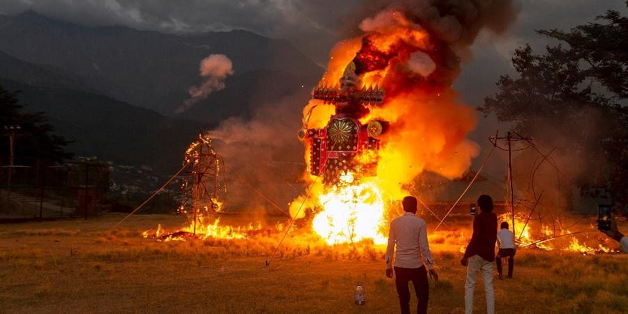 Effigies of Ravana and his kins are burned during Dussehra festival celebrations toned down due to the coronavirus pandemic in Dharmsala.
