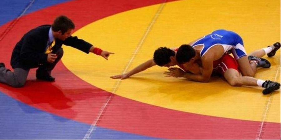 Image of a wrestling match used for representational purpose only