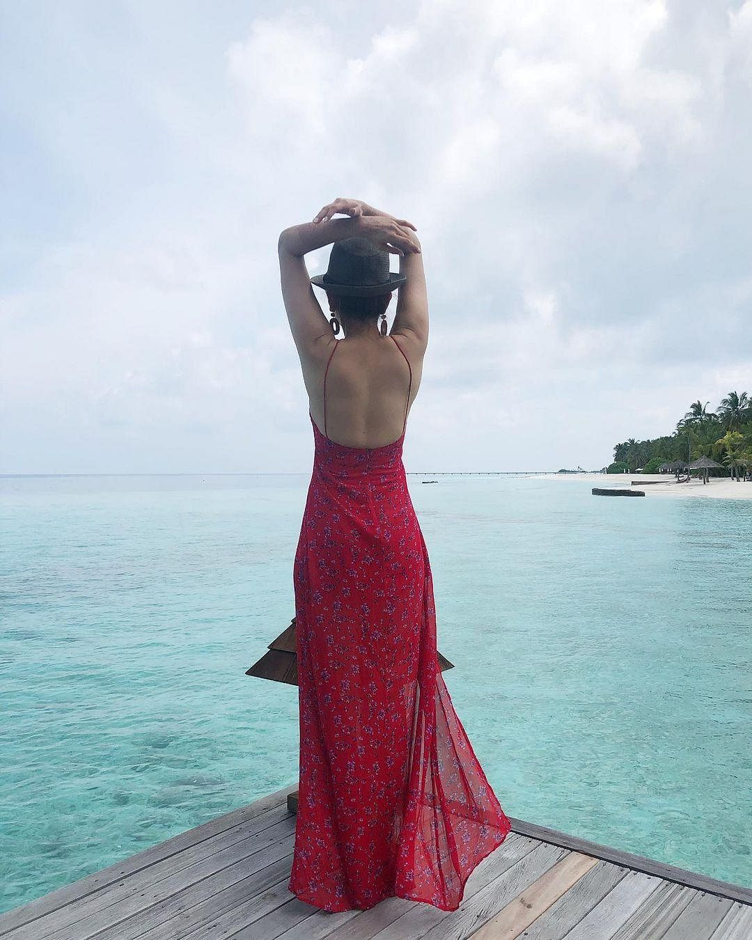 From posing against the backdrop of the azure blue waters of the Indian Ocean along with Gautam to flaunting her red dress, Kajal's pictures are surely a feast for the eyes.