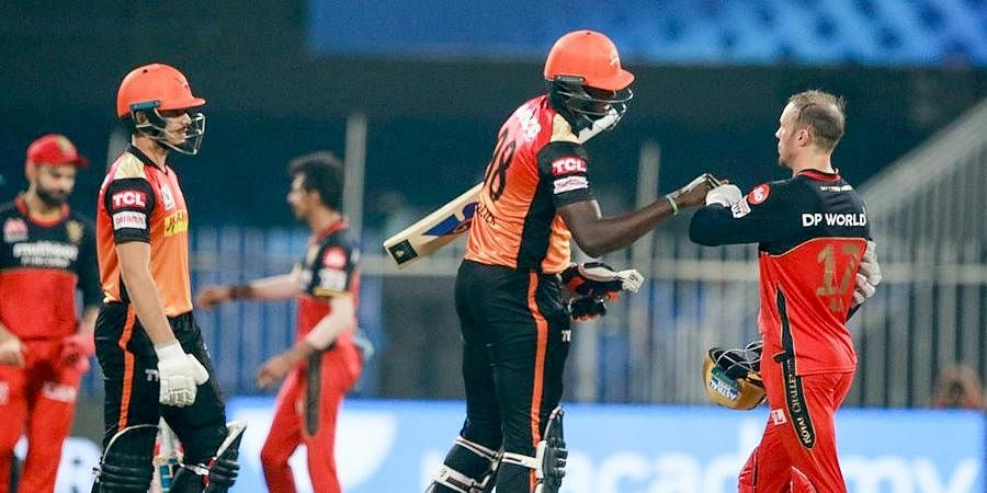 Sunrisers Hyderabad batsmen Jason Holder and Abdul Samad after winning a match against Royal Challengers Bangalore during the IPL at Sharjah Cricket Stadium.