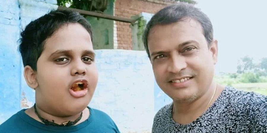 Stand-up comedian and television actor Rajeev Nigam (R) with his son Devraj.