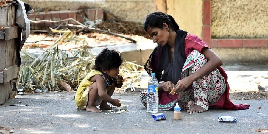 This homeless woman feeds her kid with the sourced food, without worrying least about filling her stomach. (Photo for representational purposes | P Jawahar, EPS)