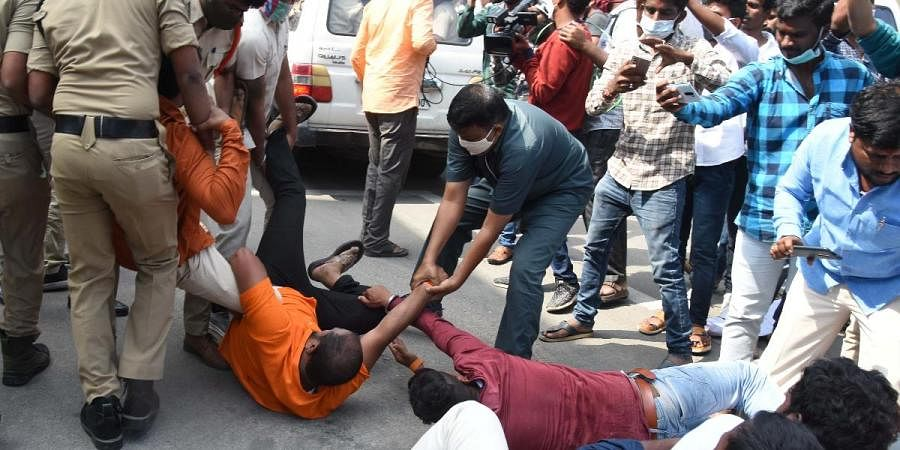 Police detain BJP activists who staged a protest against TRS leaders near SEC office in Hyderabad
