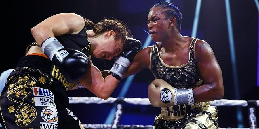 Claressa Shields (R) signed with the Professional Fighters League in a quest to become the first woman to hold simultaneous titles in both MMA and boxing.