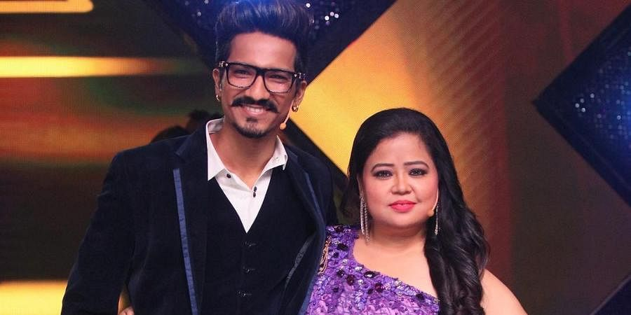 Writer Haarsh Limbachiyaa with his wife and comedian Bharti Singh.