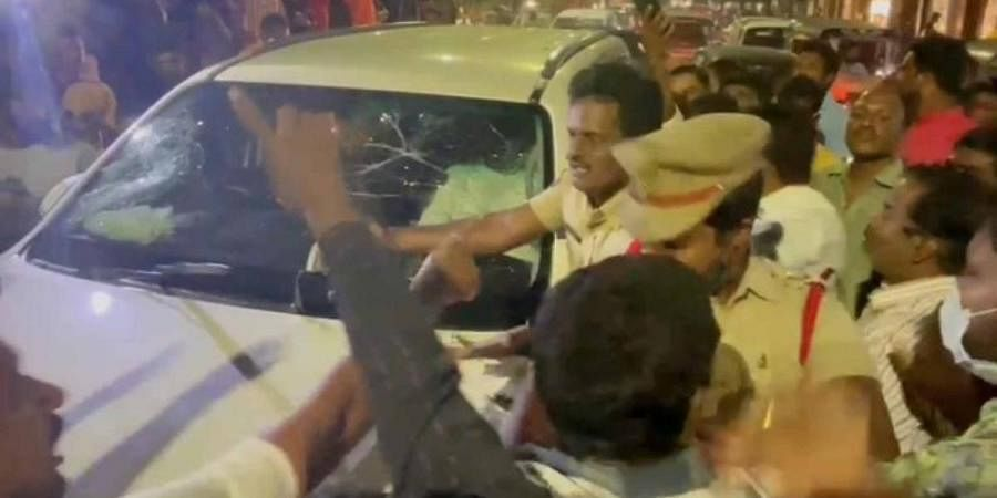 BJP corporator P Vijaya Reddy along with other workers who attacked the car