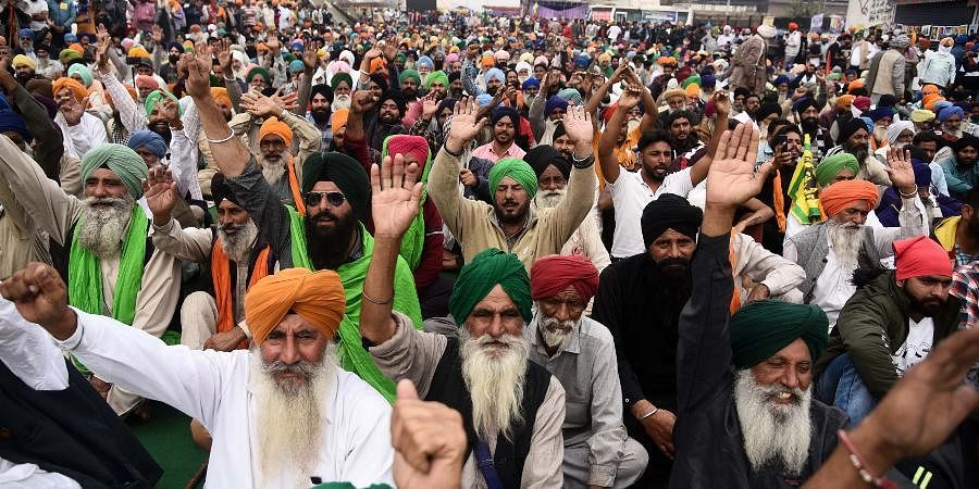 Farmers at Singhu border during their Delhi Chalo protest march against the Centres new farm laws in New Delhi.