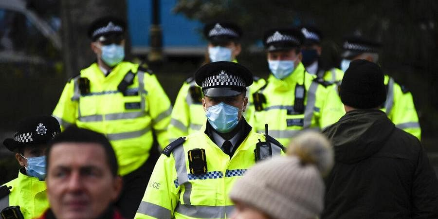 Police officers wear face masks as they patrol an anti-lockdown demonstration in Parliament Square, in London. (Photo | AP)