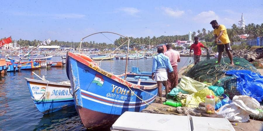 Fishermen take their boats to safety at Vizhinjam following the cyclone warning issued by the IMD. (Photo| Vincent Pulickal, EPS)