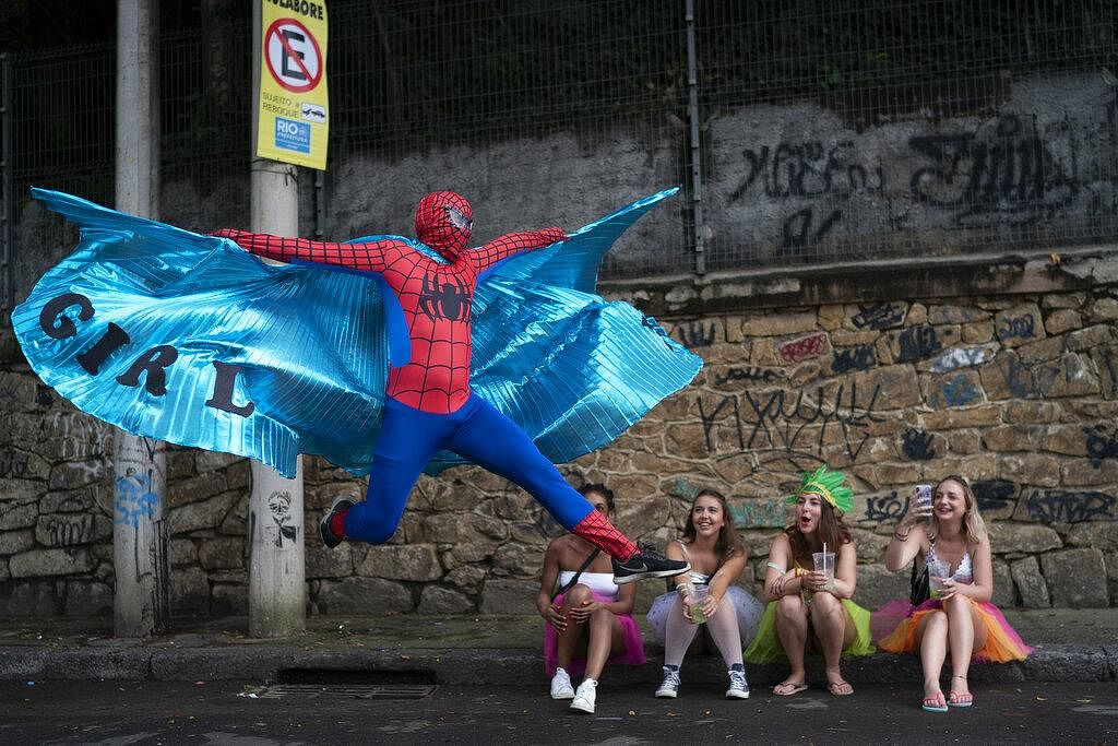 A reveler dressed in a Spider-Man costume strikes a pose at the 'Ceu na Terra' or Heaven on Earth street party in Rio de Janeiro, Brazil on February 22, 2020, during the Carnival celebration.