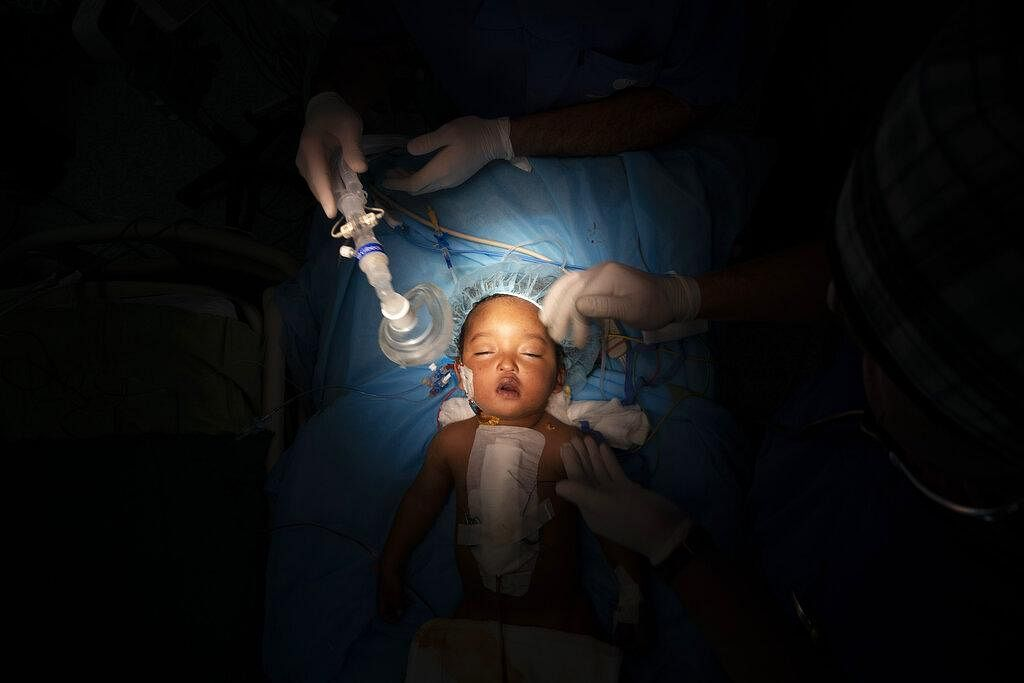 One-year-old Yazan has his oxygen mask removed after heart surgery at the Tajoura National Heart Center in Tripoli, Libya, on February 27, 2020. Yazan's perilous trek from his small desert hometown culminated in a five-hour surgery. He is one of 1,000 children treated by Dr. William Novick's group since it first came to Libya after the 2011 uprising.
