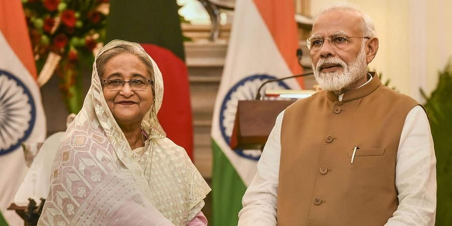 Prime Minister Narendra Modi (R) with his Bangladeshi counterpart Sheikh Hasina