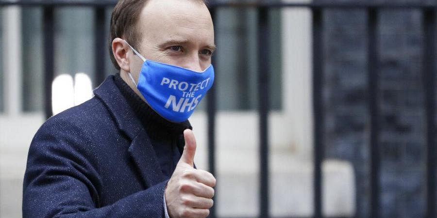 Britain's Health Secretary Matt Hancock leaves Downing Street in London.