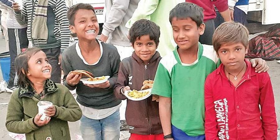 The children are all smiles after receiving food from the farmers.