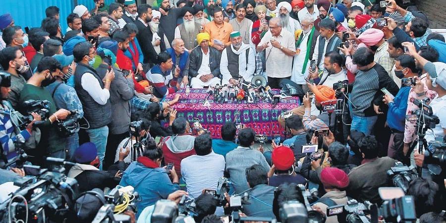 Representatives of farmer unions address the media, near the Singhu border in New Delhi.