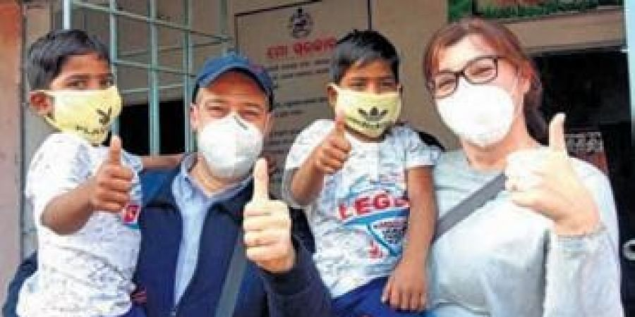 The couple from Italy with the adopted twins at Baripada| ExprEss