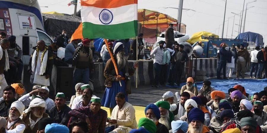 A Nihang holds the Tricolor at Ghazipur border during farmers protest against Centres agri-laws in New Delhi. (Photo | Parveen Negi/EPS)