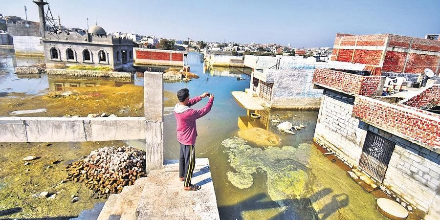A resident takes an aerial photo of the stagnant water in Osman Nagar, on the outskirts of Hyderabad. (Photo | S Senbagapandiyan, EPS)