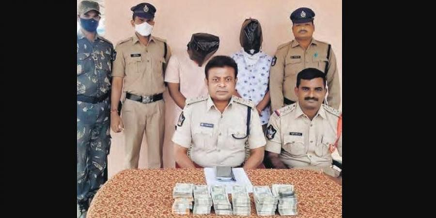 Mydukur DSP B Vijay Kumar produces two of three ATM custodians accused of  siphoning off `60 lakh, before mediapersons in Kadapa on Sunday