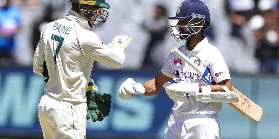 Australian captain Tim Paine, left, congratulates Indian captain Ajinkya Rahane after winning the second cricket test at the Melbourne Cricket Ground. (Photo | AP)