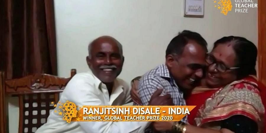 Ranjitsinh Disale with his parents when the prize was announced.