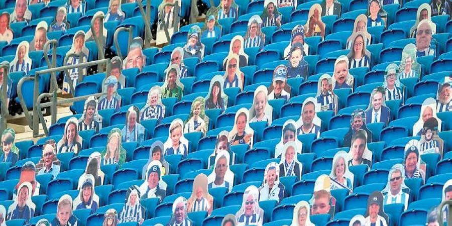 Cardboard cutout photograph of supporters was a common sight in football stadiums as matches were played behind closed doors   AFP