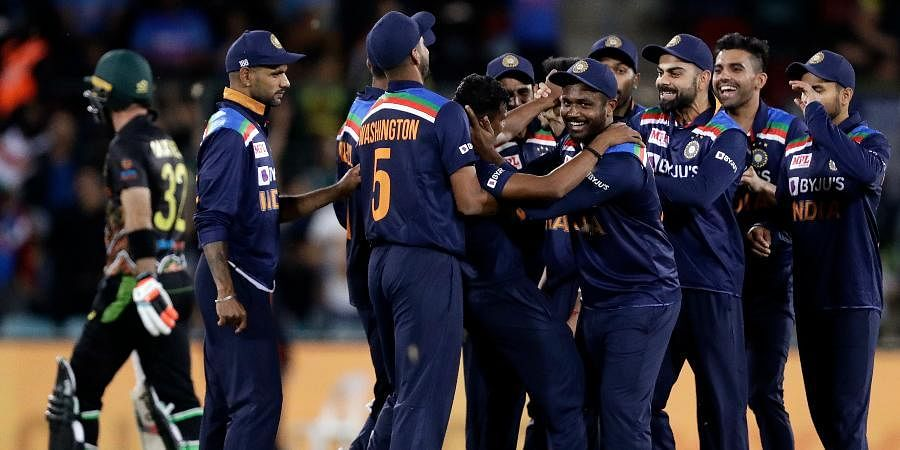 Indian teammates celebrate the wicket of Australia's Glenn Maxwell during their T20Imatch at Manuka Oval, in Canberra.