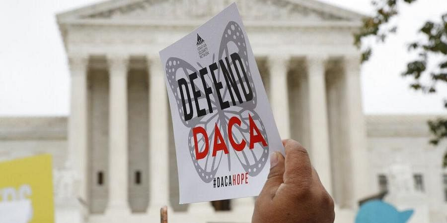 people rally outside the Supreme Court as oral arguments are heard in the case of President Trump's decision to end the Obama-era, Deferred Action for Childhood Arrivals program (DACA), at the Supreme Court in Washington.