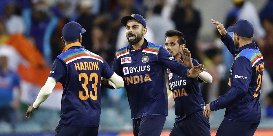India's Virat Kohli, second left, celebrates after taking a catch to dismiss Australia's Matthew Wade during their T20 international cricket match. (Photo | AP)
