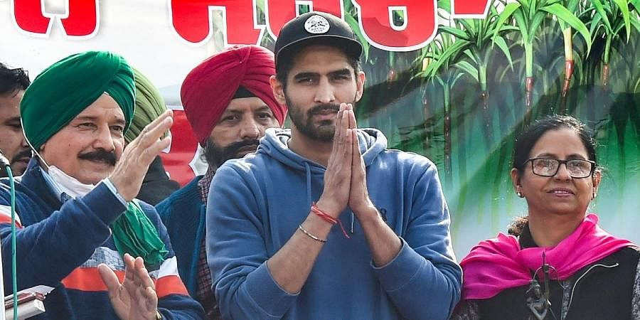 Boxer Vijender Singh joins the farmers with Arjuna and Dronacharya awardees during their 'Delhi Chalo' protest march against the new farm laws at Singhu border in New Delhi, Sunday Dec. 6 2020.