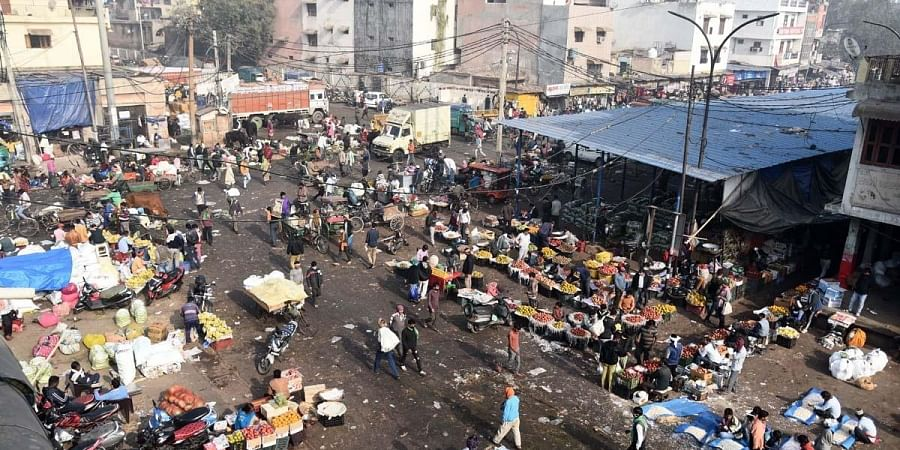 Crowd at Azadpur vegetable market amid a nationwide strike called by agitating farmers to press for repeal of the Centre's agri laws in New Delhi Tuesday. (Photo   Parveen Negi, EPS)